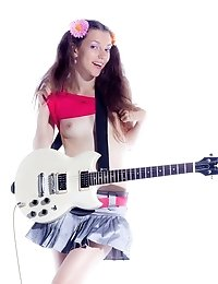 Charming Teen With Electric Guitar Stripping And Showing Her Perky Tits And Alluring Holes.