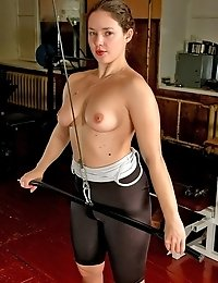 Naked muscle chick working with weights