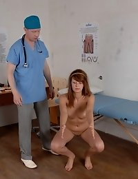 Male doctor carries out a nude sports exam