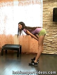 Trainer exercises and dildo-stuffs a nude gymnast