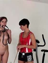 Sweat-covered nude slave of a lesdom fitness mistress