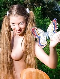 Gorgeous Long Haired Teen Girl Stripping And Catching A Wonderful Butterfly In The Meadow.