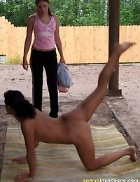 Naked model doing gymnastic exercises alfresco