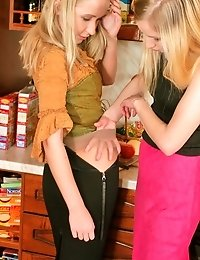 Young lesbian couple playing in kitchen
