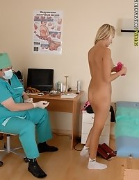 Pushy male doctor inspects a naked blondie