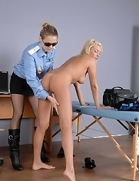 Two officers examine their customs booty