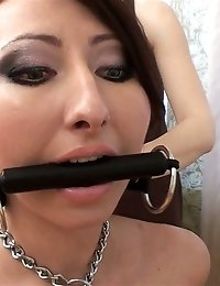 Nude gagged and collared pet of a sports domina