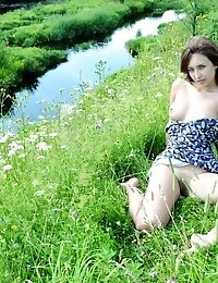 Busty Beauty Queen Enjoys The Warm Sunshine Beside Crystal Clear Creek. Natural Beauty In Natural En