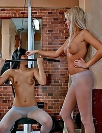 Gym routine of two slim beauties in tights