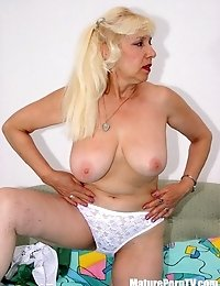 Blonde bitch in white blouse and green skirt undressing and posing