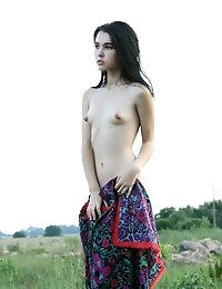 Charming Slim Teenie With An Exotic Face Showing Off Her Tiny Tits With Big Puffy Nipples.