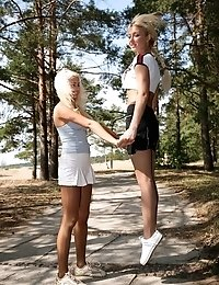 Two blonde girls in pantyhose doing aerobics outdoors