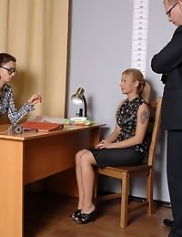 Female and male staff clerks undress a business blondie