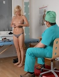 Gynecological exam of a confused nude blonde