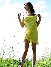 Modern Girl In Pure Nature With A Slight Touch Of Retro Outlook. She Knows That The Dress Is Actuall