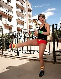 Sporty Intimate in pantyhose with jumping rope outdoors