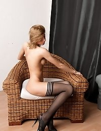 Stretching in the chair only in the black stockings