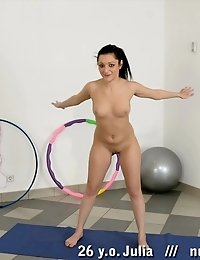 Naked brunette doing workouts and rubbing her clit