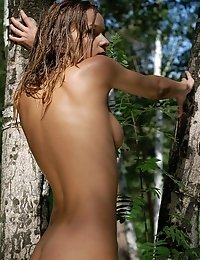 Stunning Cutie With Burning Look And Intriguing Smile Posing All Nude In The Depths Of The Forest