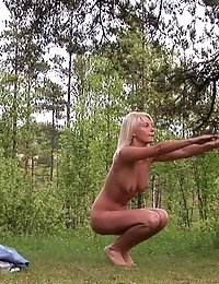 Naked blondie stretches and backbends outside