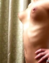 Exhausting naked gymnastics by a well-stacked beauty