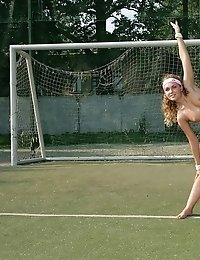 Naked cheerleader meets sunrise at football field