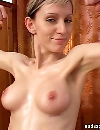 Slim big-titted girl does naked exercises