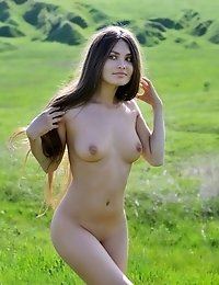 Enchanting Long Haired Teen Beautie Showing Her Perfect Body Outdoors In The Countryside.