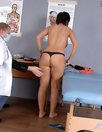 Busty naked babe in total gynecological order