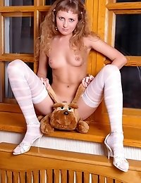 Naked Gorgeous Blonde In Sexy White Stockings Exposing Her Awesome Body And You Cant Resist Her Unfa