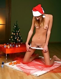 Lovely Teen In Christmas Hat, But Fully Nude, Sits On The Floor And Entertains With Many-coloured Ch