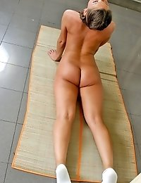 Cute girl working on her fitness naked