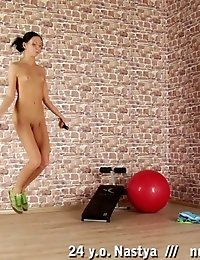 Fitness and gymnastics workouts by a slim brune babe