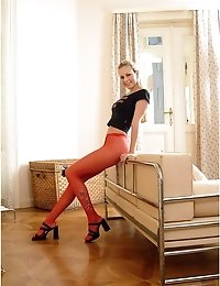 Modest girl in red pantyhose
