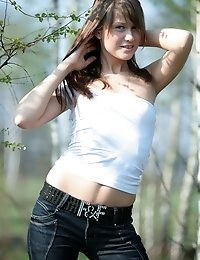 It Is A Nice Chance For Pretty Teen Girl To Pose Naked And To Show Her Body In The Woods.