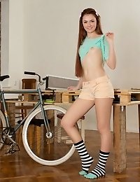 This Hot Babe Embraces Her Flawless Shapes Her Room Where She Puts Her Booty Beside The Bicycle She