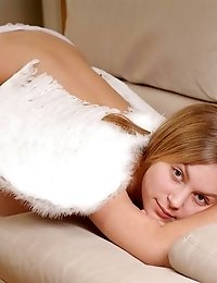 Charming Nude Angel Has Flown On The Beige Sofa And Demonstrated The Startling Treasures Of Hers.