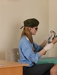 Military lady doc performs a gyno examination