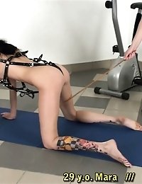 Tattooed and harnessed bitch of a sports mistress