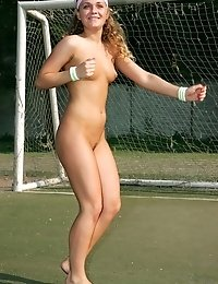 Sporty blonde exhibitionist hits the football field