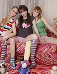 Three Naughty Teen Babes Playfully Helping Each Other To Get Nude And Showing Their Bushes.