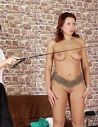BDSM gymnastics training of a big-titted tall slut