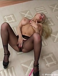 Busty blonde woman spreading legs in pantyhose