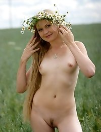 Fabulous Attractive Nude Angel Is Wandering In The Valley In A Chamomile Garland And Is Looking For