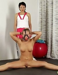 Gagged and collared naked sports training