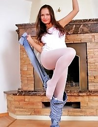 Busty brunette Luiza takes down jeans and shows white pantyhose