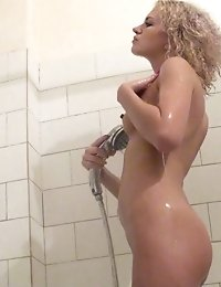 Shower spycam view of a blonde beauty