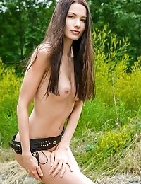 Amazing Teen Chick With Lovely Dark Hair And Impressive C-cup Boobs Posing On A Big Stump.