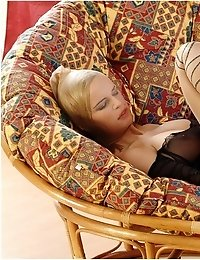 Cute blonde Peach in pantyhose mask spreading legs in pantyhose on sofa