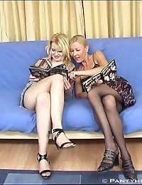 Two hot girls in pantyhose licking each other